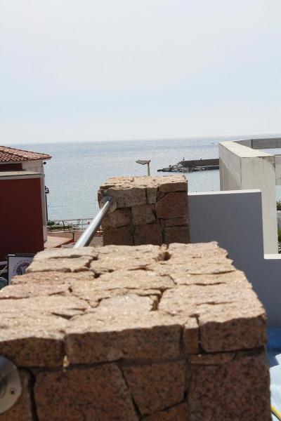 Vista dal terrazzo Affitto Appartamento 61212 Isola Rossa